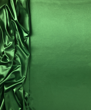 Smooth elegant gren silk or satin texture can use as abstract background. Luxurious background design