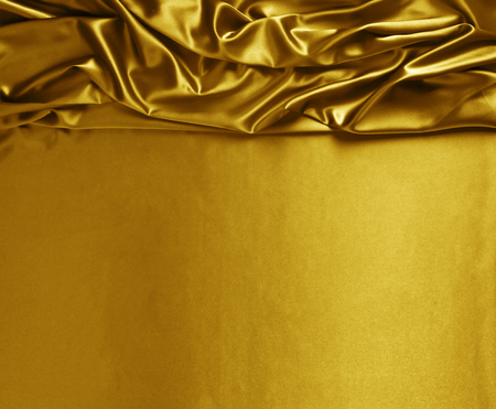 Smooth elegant gold silk or satin texture can use as abstract background. Luxurious background design