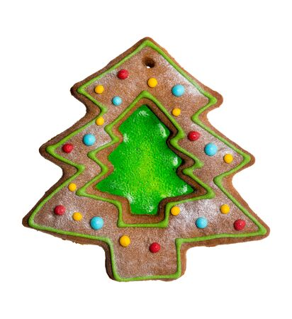 Christmas tree, sweet ginger bread with green caramel isolated on white background