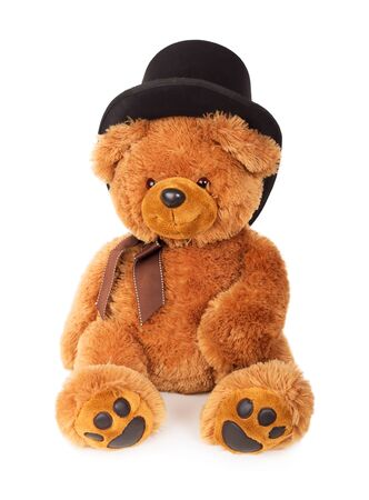 Toy teddy bear with black hat isolated on white background