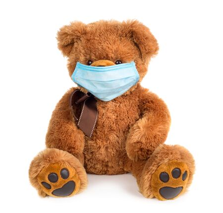 Teddy bear with medical mask isolated on white background Foto de archivo