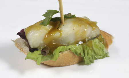 bacalao: Skewer bacalao al pil pil with lettuce and parsley