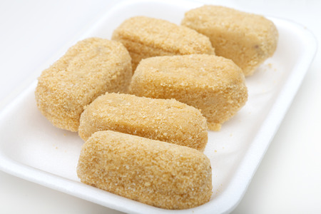 coatings: Cod croquettes on white background