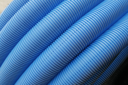 public works: blue corrugated tube for transporting water