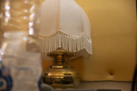 image of a interior lamp with the lights off on a neutral wall Imagens