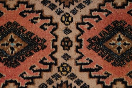 close-up photograph of the texture of a carpet with geometric embroidery