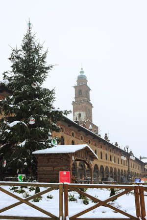 A walk in the historic center of vigevano with views of the Piazza Ducale and the sforzesco castle in Vigevano during a snowfall in 2012 Editorial