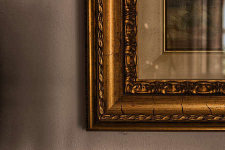 A small portion or a corner of A frame of a painting