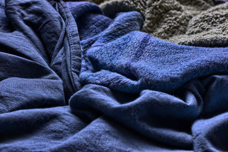 closeup of a messy blue blanket Imagens