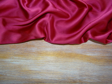 red silk: red silk over wooden boards