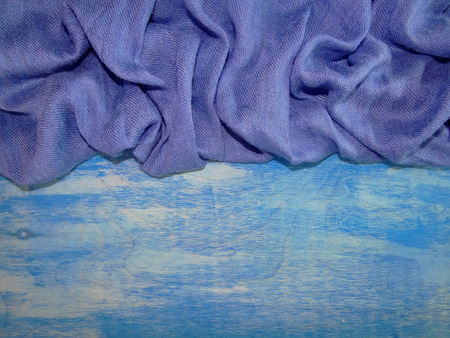 threadbare: blue cloth on blue wooden boards Stock Photo