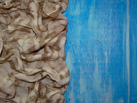crease: brown cloth with drawings