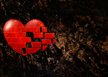 broken love: rocky background with heart