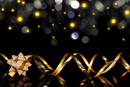 beautiful festive background, golden serpentine on a black background
