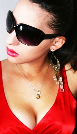 sunglassess: beautiful young girl with dark sunglassess with red dress