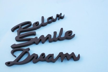 ble: Close up of the words smile relax and, dream on a ble background Stock Photo