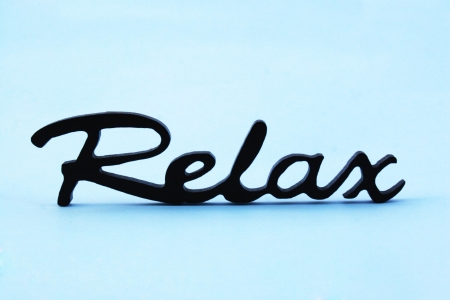 Close up of the word relax on a blue background photo