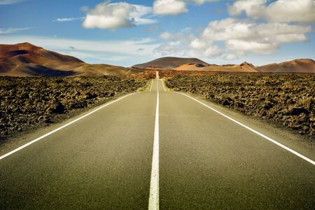 No people, no animals, no vegetation. Just me, the road and the blue sky in the middle of a volcanic lava sea