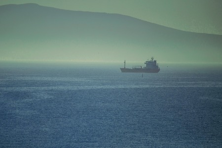 Cargo ships waiting to enter the Novorossiysk port in foggy weather