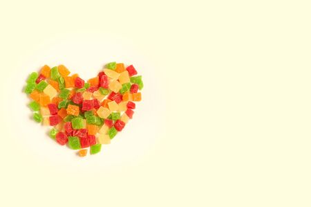Heap of colorful delicious candied fruits in shape of heart on white background 版權商用圖片