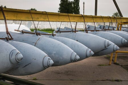 Aerial bombs fixed in line at closed military airfield.