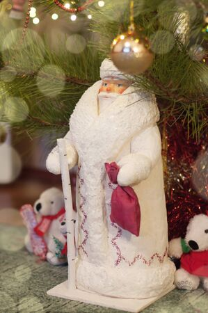 Vintage figure of Ded Moroz, or Jack Frost, or Santa Claus standing under a Christmas tree at home. This toy was manufactured in 1983 in USSR. Stok Fotoğraf