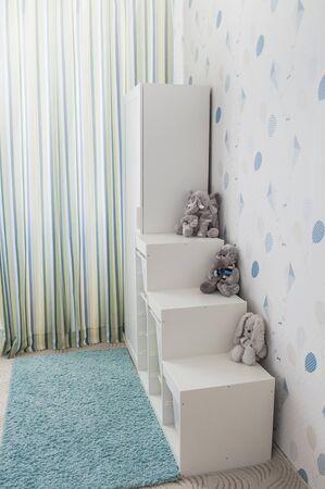 Toy storage rack in childrens's room Stockfoto