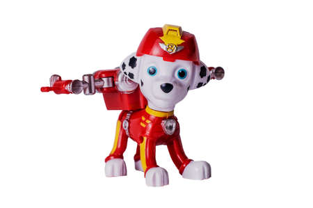 7 November 2019, Voronezh, Russia. Macro photography of Paw Patrol character Marshall on a white background. Popular child cartoons around the world. Illustrative editorial. Editorial