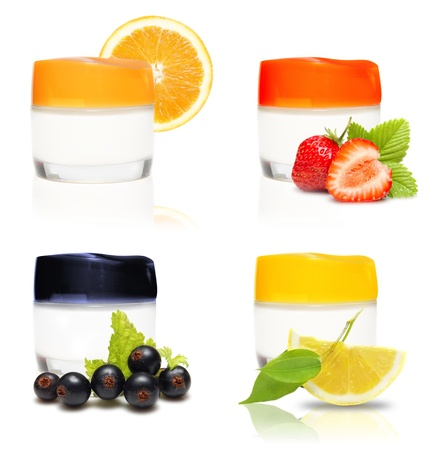 Containers of cream and fresh fruits and berries isolated  photo