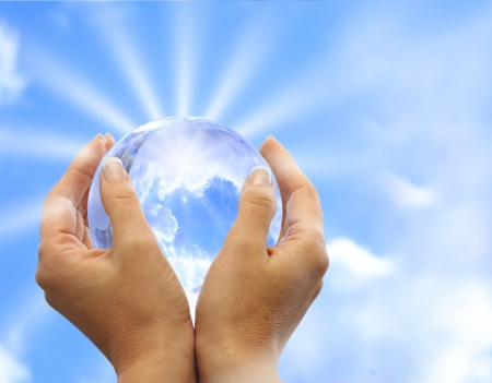 Globe in human hand against blue sky  Environmental protection concept Stock Photo - 17305785