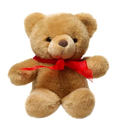 osos de peluche: Clásico oso de peluche con el arco rojo aislado sobre fondo blanco