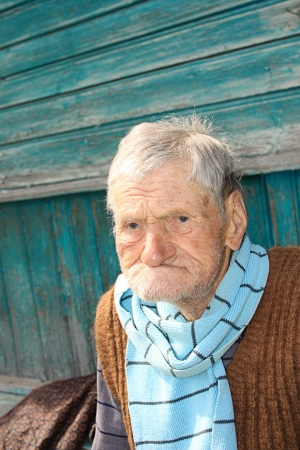 end of a long day: A portrait of a very old man, 96 years old near his house
