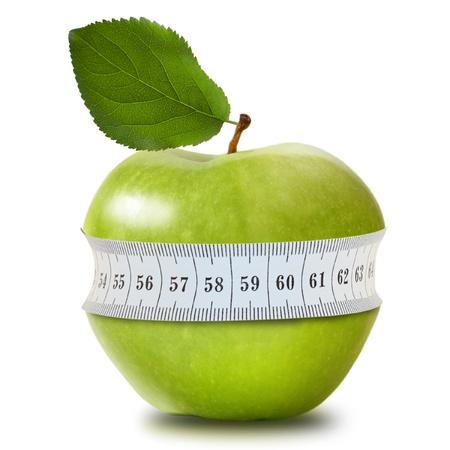 manzana verde: Manzana verde con medida aislada en blanco Foto de archivo