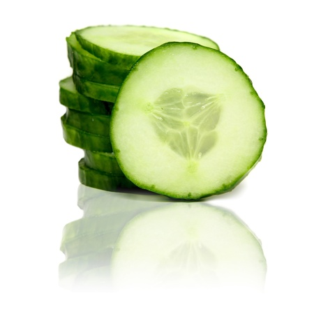 Stack of green cucumber slices with reflection isolated on white