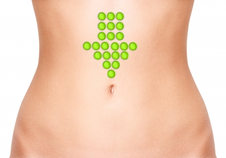 digesting: rrow on woman belly isolated on white background