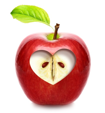 Apple with heart isolated over white background photo