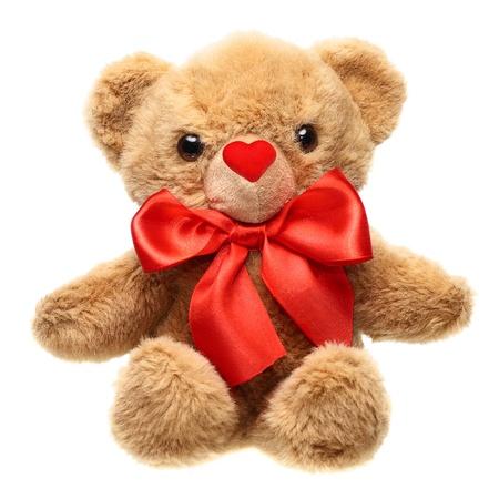 ositos bear: Clásico oso de peluche con el arco rojo aislado sobre fondo blanco