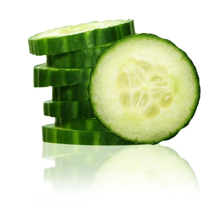 cucumber slice: Stack of green cucumber slices with reflection isolated on white