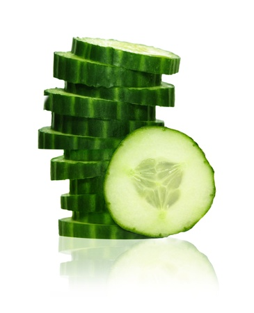 Stack of green cucumber slices with reflection isolated on white photo