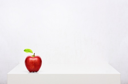 Red apple on the white shelf Stock Photo - 18127414