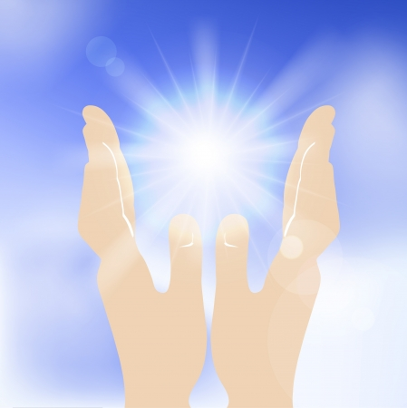 Sun in human hands against blue sky.  photo