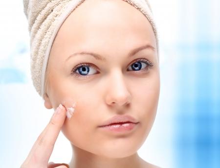 moisturize: Beautiful woman applying moisturize cream