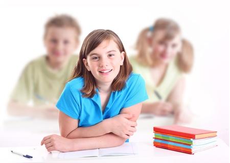 Portrait of teenage girl in classroom. photo