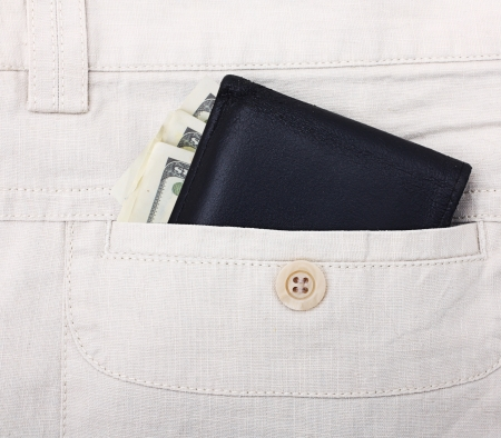 jeans pocket: Black wallet with money in back pocket. Stock Photo
