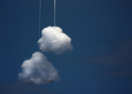 cotton cloud: Two cotton wool cloud against blue background.