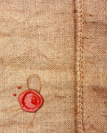 Burlap hessian sacking with wax seal stamp. Stock Photo - 20584939