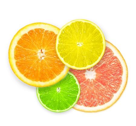 citricos: Pila de rodajas de c�tricos aisladas sobre fondo blanco. Foto de archivo
