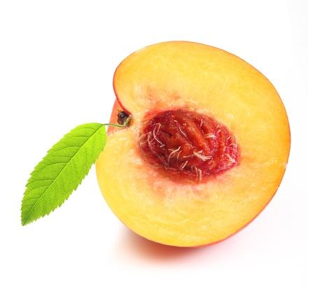 Peach slice isolated on white photo