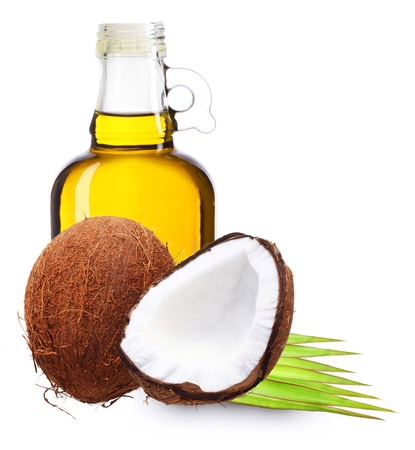 Coconut oil with palm leaves isolated on white  photo