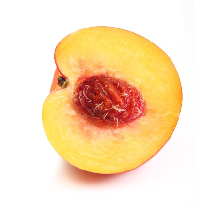 Peach slice isolated on white photo